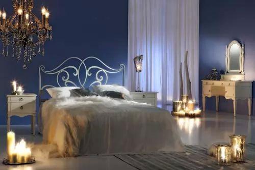 صور - كيف يمكن تزيين غرف النوم بالشموع ؟
