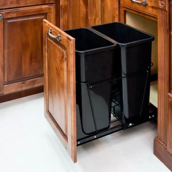 توفير اماكن مخفية بالمطبخ لسلات القمامة من الطرق العصرية لترتيب المنزل